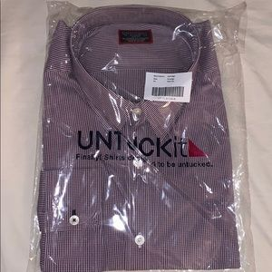 Untuckit button up in its packaging, never used.